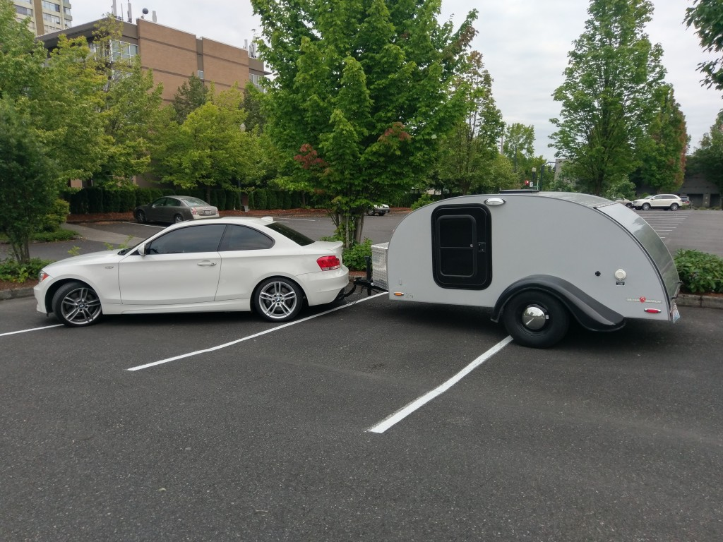 BMW 135i towing a teardrop camper trailer